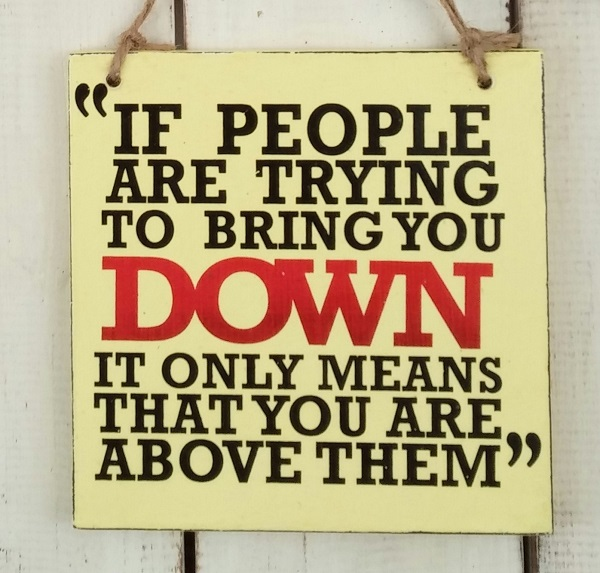 Text: IF PEOPLE ARE TRYING TO BRING YOU DOWN..
