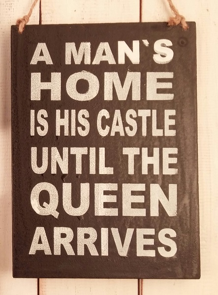 Text:  A MAN´S HOME IS HIS CASTLE UNTIL THE QUEEN..