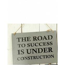 Text: THE ROAD TO SUCCES IS UNDER..
