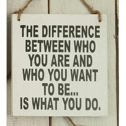 Text: THE DIFFERENCE BETWEEN WHO YOU ARE AND WHO YOU..